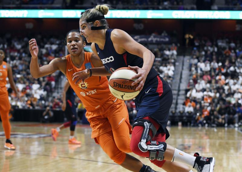 Washington Mystics' Elena Delle Donne, front, drives to the basket against Connecticut Sun's Alyssa Thomas during the second half in Game 3 of basketball's WNBA Finals, Sunday, Oct. 6, 2019, in Uncasville, Conn. (AP Photo/Jessica Hill)