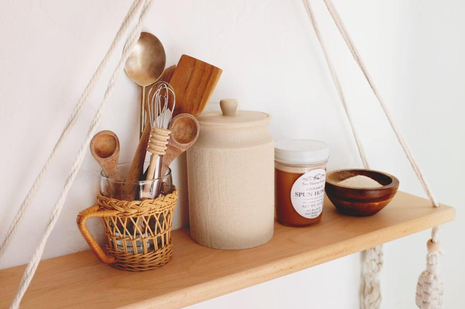 <p>This shelf can pack a big punch in the kitchen with the right vessels. Keep everything earthy and boho with a rattan-wrapped glass for utensils, a wood canister for dry goods, and mini wood prep bowl for easy-to-grab spices.</p>