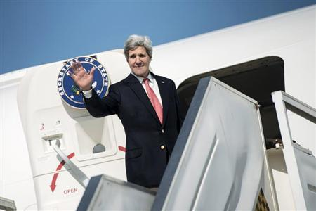 U.S. Secretary of State Kerry waves as he boards his plane at Ben Gurion International Airport in Tel Aviv
