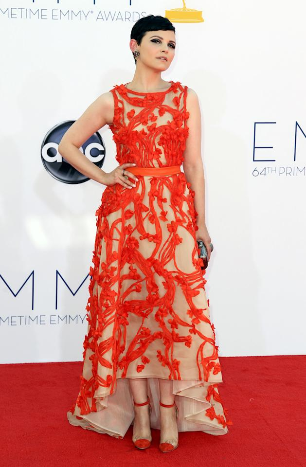 FILE - This Sept. 23, 2012 file photo shows actress Ginnifer Goodwin arriving at the 64th Primetime Emmy Awards at the Nokia Theatre in Los Angeles. Sunday's Emmy Awards opened the first big fashion red-carpet of the season _ and it was a long runway: a parade of rainbow-bright gowns, skyscraper heels, glittering clutches that only hold a lipstick, along with millions of dollars in jewels. (Photo by Matt Sayles/Invision/AP, file)