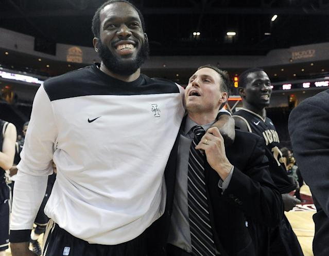 Idaho's Roberto Asencio, left, and assistant coach Chris Helbling celebrate after defeating Utah Valley, 74 -69, in an NCAA college men's basketball game in the semifinals of the West Athletic Conference tournament Friday, March 14, 2014, in Las Vegas. (AP Photo/David Becker)