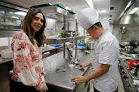 Delphyne Dabezies, head of Rova Caviar, and Chef Gang Yu pose at the Imperial Treasure Restaurant in Paris