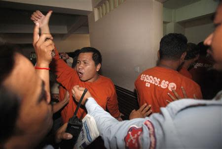 A man convicted of plotting to overthrow the Cambodian government shouts after being sentenced at the Phnom Penh Municipal Court