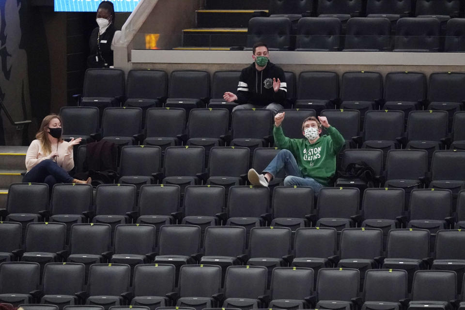 Boston Celtics employees cheer from their seats during an NBA basketball game between the Celtics and the Sacramento Kings, Friday, March 19, 2021, in Boston. TD Garden officials are preparing for the return of a limited amount of fans starting the week of March 22. (AP Photo/Elise Amendola)