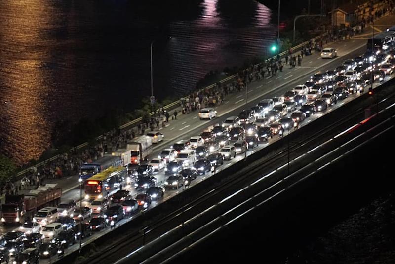 Thousands of cars and people heading towards Singapore along the Causeway on the night of 17 March 2020, ahead of the start of the lockdown in Malaysian on 18 March 2020. (PHOTO: Dhany Osman/Yahoo News Singapore)