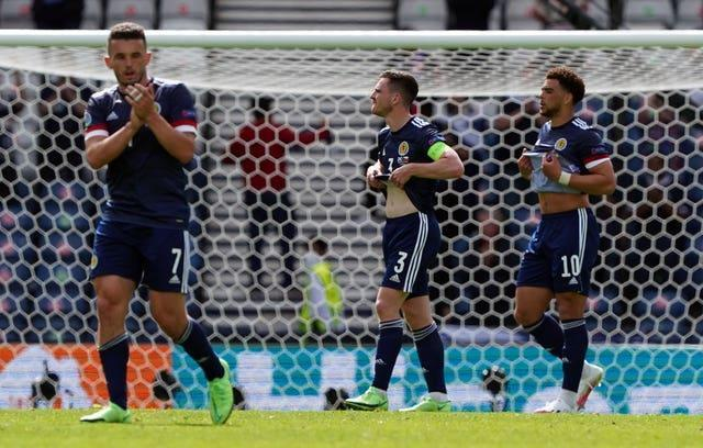 John McGinn (left) and his team-mates reflect on their opening defeat