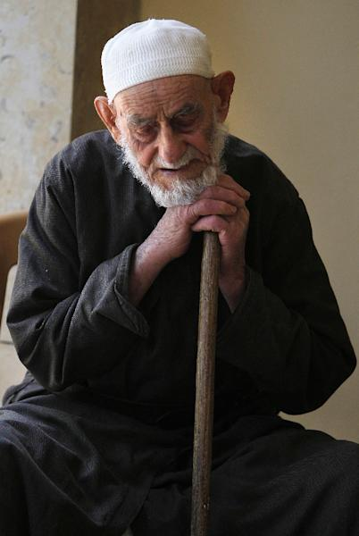 Palestinian refugee Abdel Qader al-Lahham, who was born in 1921 in the village of Beit Atab, which is now in Israel, sits during an interview with AFP at the Dheisheh Refugee Camp south of the West Bank town of Bethlehem on May 14, 2017 (AFP Photo/Musa AL SHAER)