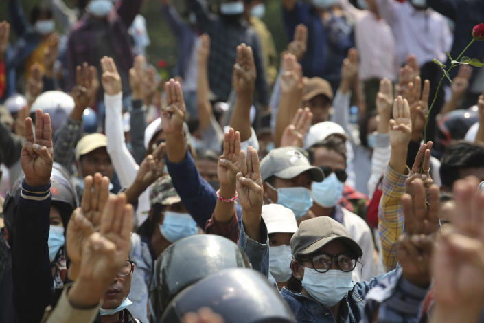 Anti-coup protesters flash a three-fingered sign of resistance during a demonstration in Naypyitaw, Myanmar, Monday, March 8, 2021. The escalation of violence in Myanmar as authorities crack down on protests against the Feb. 1 coup is raising pressure for more sanctions against the junta, even as countries struggle over how to best sway military leaders inured to global condemnation. (AP Photo)