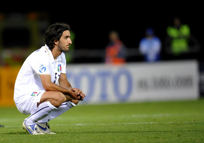 (FILES) A file picture taken on June 26, 2009 shows Italian player Piermario Morosini (C) reacting after losing the Euro U21 football championships semi-final match against Germany at the Olympia Arena in Helsingborg. Liovrno midfielder Piermario Morosini has died after suffering a suspected heart-attack during a match at Pescara on April 14, 2012, Italian media reported. The 31-year-old collapsed suddenly on the pitch during the game against Pescara leading to the match being abandoned.  AFP PHOTO / SCANPIX SWEDEN / Pontus Lundahl    ***SWEDEN OUT***