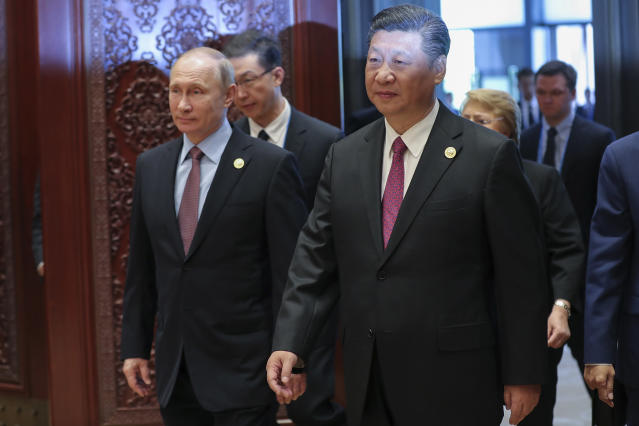 Russia's President Vladimir Putin, left, and Chinese President Xi Jinping attend the Roundtable Summit Phase One Sessions of Belt and Road Forum at the International Conference Center in Yanqi Lake on May 15, 2017, in Beijing. (Photo: Lintao Zhang/Pool/Getty Images)