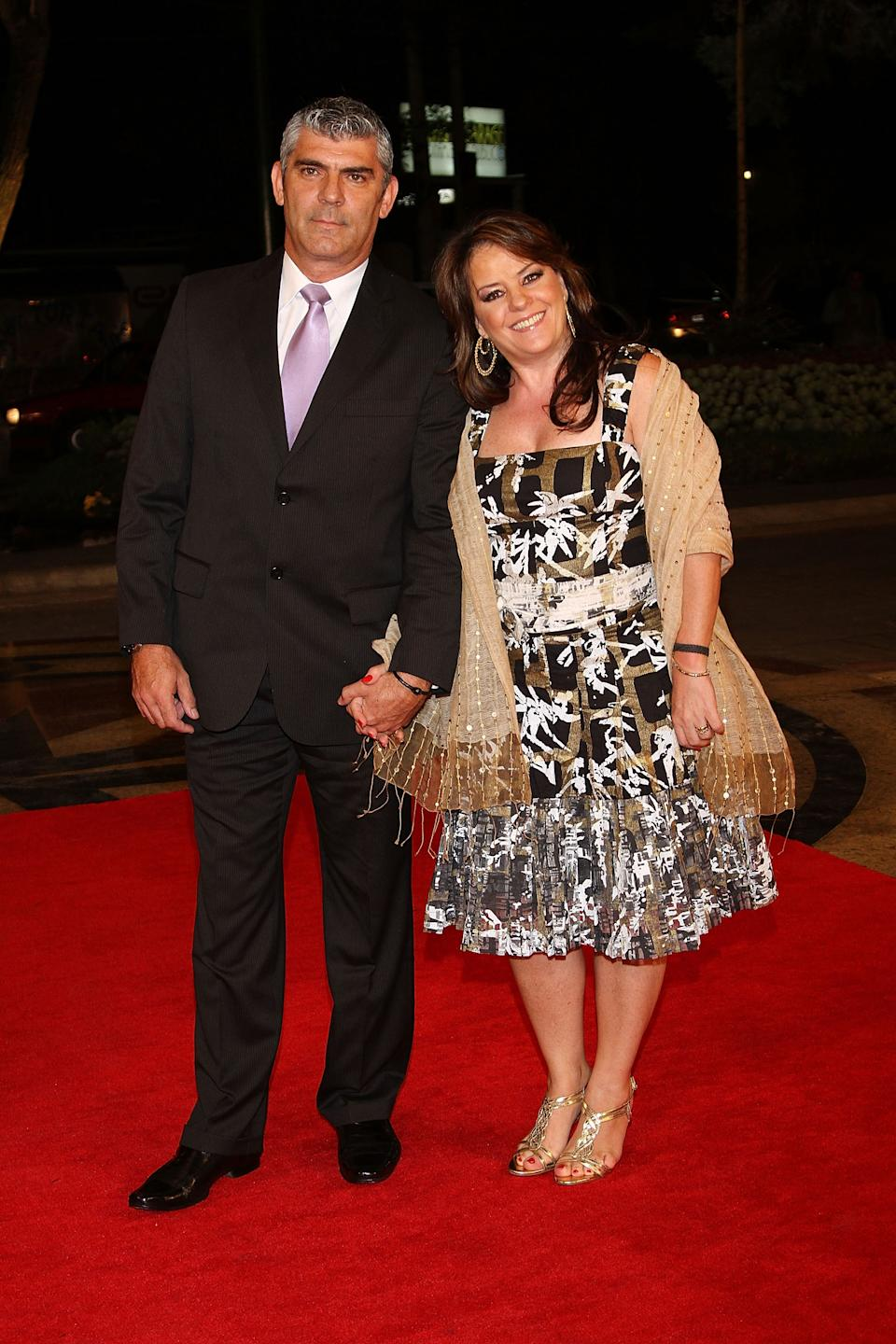 MEXICO CITY - SEPTEMBER 14:  Isabel Lascurain (R) and her husband attends the Miss Universe 2010 Gala Night at Crowne Plaza Hotel on September 14, 2010 in Mexico City, Mexico.  (Photo by Victor Chavez/WireImage)