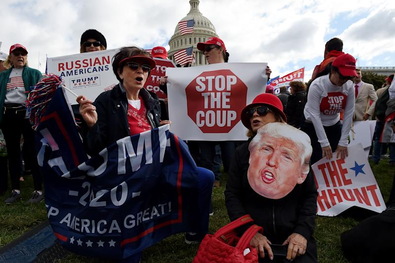Supporters of President Donald Trump hold a
