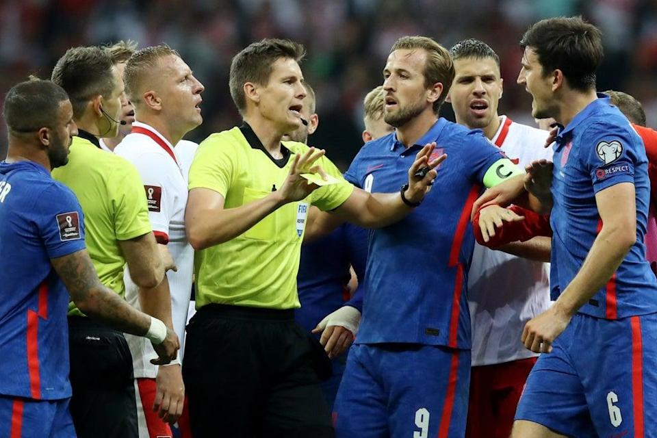 There were furious scenes after the half-time whistle between Poland and England  (REUTERS)