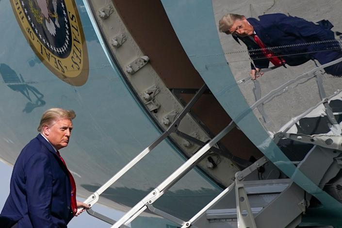 <p>Donald Trump boards Air Force One in Florida on Thursday</p> (AP)