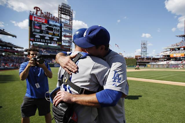 Los Angeles Dodgers starting pitcher Josh Beckett right, celebrates with catcher Drew Butera after pitching a no-hitter baseball game against the Philadelphia Phillies, Sunday, May 25, 2014, in Philadelphia. Los Angeles won 6-0. Beckett pitched the first no-hitter of his career and the first in the majors this season. (AP Photo/Matt Slocum)