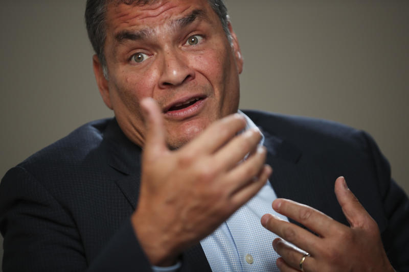 "Former Ecuador President Rafael Correa answered questions during an interview with Associated Press in Brussels, Thursday, Oct. 10, 2019. Correa is dismissing as ""nonsense"" allegations that he is plotting with Venezuela President Nicolas Maduro to destabilize the current Ecuador government amid violent unrest sparked by fuel price hikes. (AP Photo/Francisco Seco)"