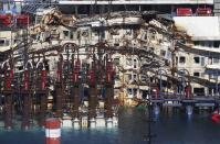 "A damaged part of the cruise liner Costa Concordia is seen at Giglio harbour, Giglio Island July 13, 2014. Italian authorities gave the green light to refloating the wrecked Costa Concordia cruise ship on Saturday, setting the stage for the next step in the largest maritime salvage in history to begin on Monday morning. The defunct luxury liner is due to depart Giglio on July 21, two and a half years after it struck a reef while performing a display manoeuvre to move close to shore and ""salute"" the port. REUTERS/Alessandro Bianchi (ITALY - Tags: DISASTER TRANSPORT MARITIME)"