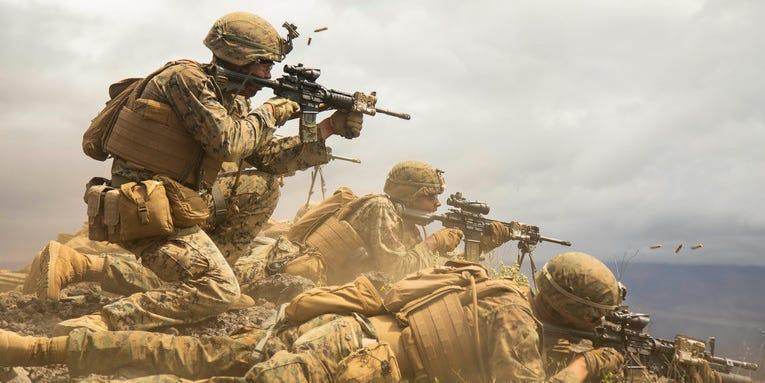Marines fire at targets during a mock platoon-supported attack as part of Exercise Bougainville II at Pōhakuloa Training Area, Hawaii, May 9, 2019.