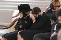 """Family members, including Billye Aaron, left, and Ceci Aaron, second from left, weep during the funeral services the funeral services for Henry """"Hank"""" Aaron, longtime Atlanta Braves player and Hall of Famer, on Wednesday, Jan. 27, 2021 at Friendship Baptist Church in Atlanta. (Kevin D. Liles/Atlanta Braves via AP, Pool)"""