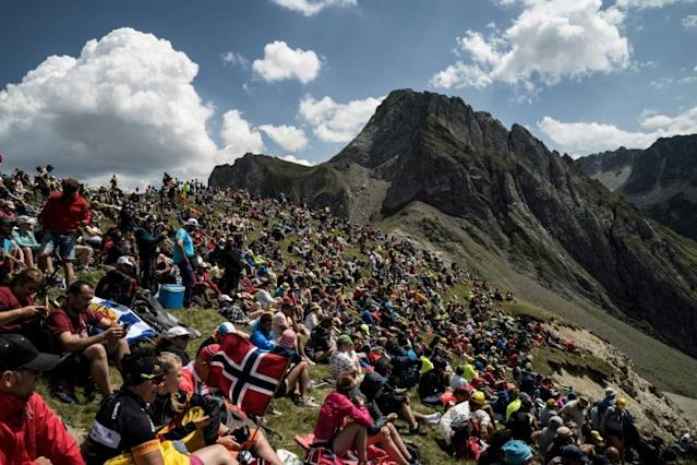 Fans await the peloton on the feared Tourmalet climb in the Pyrenees - but will crowds be allowed on the route this year? (AFP Photo/Jeff PACHOUD)