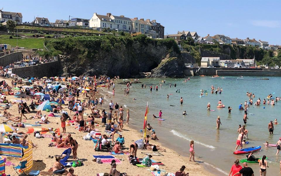 Visitors to Newquay's Towen beach soaked up the sun earlier this week - Jam Press