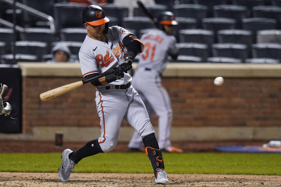 Baltimore Orioles' Ramon Urias hits a single during the ninth inning of the team's baseball game against the New York Mets on Tuesday, May 11, 2021, in New York. (AP Photo/Frank Franklin II)