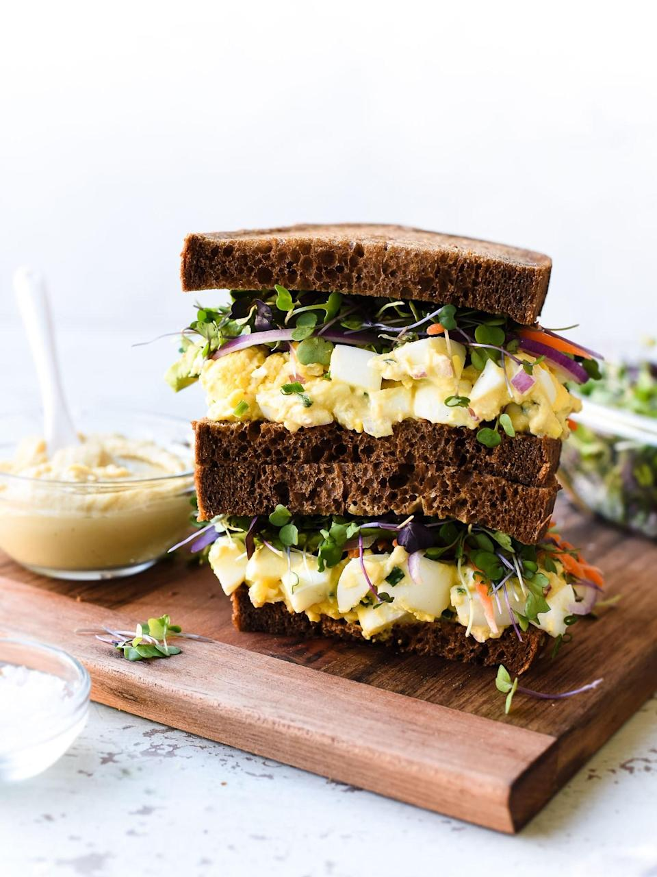 """<p>This egg salad is lighter than the traditional mayo-based version, thanks to the hummus and tahini swap. Get the recipe <a href=""""http://kitchenconfidante.com/hummus-and-tahini-egg-salad-recipe?mbid=synd_yahoofood"""" rel=""""nofollow noopener"""" target=""""_blank"""" data-ylk=""""slk:here"""" class=""""link rapid-noclick-resp"""">here</a>.</p><p><b>Per one serving of egg salad plus two slices of whole wheat bread:</b> <em>361 calories, 19 g protein</em></p>"""
