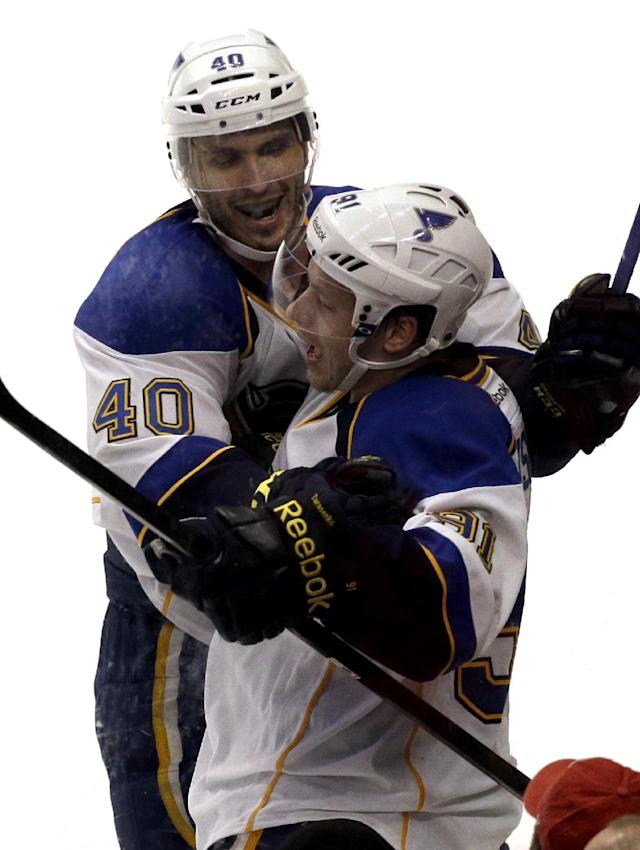 St. Louis Blues' Vladimir Tarasenko (91) celebrates with Maxim Lapierre (40) after scoring his goal during the third period in Game 4 of a first-round NHL hockey playoff series against the Chicago Blackhawks in Chicago, Wednesday, April 23, 2014. The Blackhawks won 4-3 in overtime. (AP Photo/Nam Y. Huh)