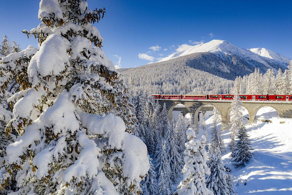 """<p>If you've spent summer enjoying calming <a href=""""https://www.countryliving.com/uk/travel-ideas/abroad/g27001987/steam-train-rides-europe/"""" rel=""""nofollow noopener"""" target=""""_blank"""" data-ylk=""""slk:steam train rides"""" class=""""link rapid-noclick-resp"""">steam train rides</a> in Britain or <a href=""""https://www.countryliving.com/uk/travel-ideas/abroad/a31203733/great-rail-journeys/"""" rel=""""nofollow noopener"""" target=""""_blank"""" data-ylk=""""slk:great rail journeys"""" class=""""link rapid-noclick-resp"""">great rail journeys</a> abroad, you'll want to browse our brilliant ideas for winter train journeys in Europe that celebrate the most magical season of the year.</p><p>We know summer is still in full swing, but it's never too early to get excited about winter, is it? The crisp woodland walks, festivities with family and friends, getting snuggly by a warm fire after a long day - we can't wait to wrap up warm and experience the cosiest time of year.</p><p>One of the best ways to travel in winter is by heading to Europe's stunning <a href=""""https://www.countryliving.com/uk/travel-ideas/abroad/a29189708/lake-mountain-holidays/"""" rel=""""nofollow noopener"""" target=""""_blank"""" data-ylk=""""slk:mountains"""" class=""""link rapid-noclick-resp"""">mountains</a> and fjords, when they're at their most icily beautiful, and you can glide past on a long, winding winter train journey as you sit back, relax and soak up the wonderful scenery.</p><p>Winter-lovers can even get a dose of the season's magic as early as October by travelling on <a href=""""https://www.countrylivingholidays.com/tours/norway-fjords-rail"""" rel=""""nofollow noopener"""" target=""""_blank"""" data-ylk=""""slk:Scandinavian railways"""" class=""""link rapid-noclick-resp"""">Scandinavian railways</a> up into Europe's far north, where the days have already shortened, and frozen temperatures transform the mountain landscapes. </p><p>Or for a classic Christmas experience, head to Switzerland in <a href=""""https://www.countrylivingholidays.com/tours/lake-como-st-moritz-bernina-railway"""" rel="""""""
