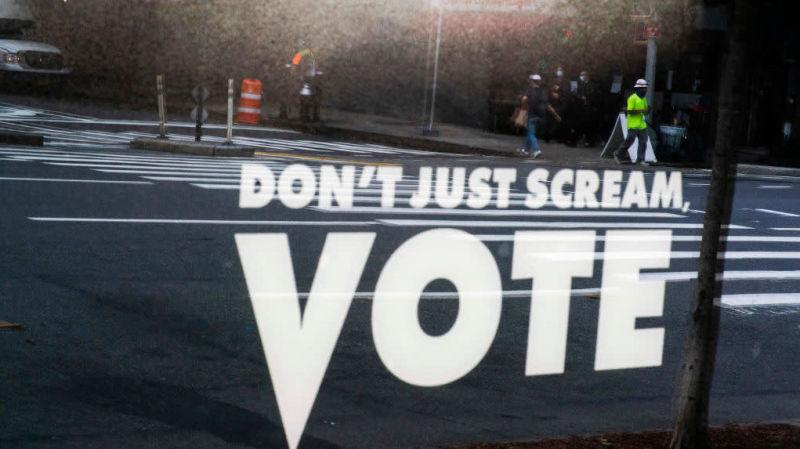 "Sign reading, ""Don't just scream, VOTE"""