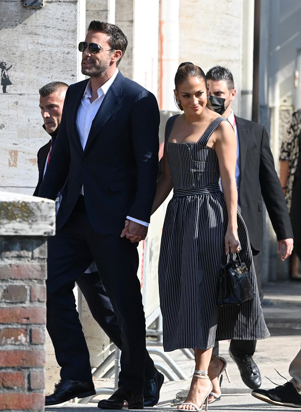 Ben Affleck and Jennifer Lopez leave at the 78th Venice International Film Festival on September 10, 2021 in Venice, Italy. (Getty Images)