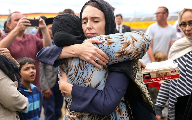 Prime Minister Jacinda Ardern hugs a mosque-goer at the Kilbirnie Mosque on Sunday in Wellington - Getty Images AsiaPac