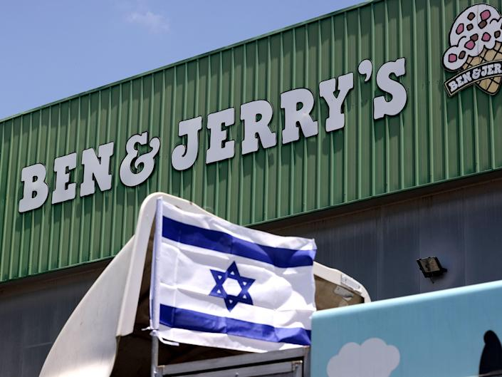 An Israeli flag is set atop a delivery truck outside US ice-cream maker Ben & Jerry's factory in Be'er Tuvia, on July 21, 2021