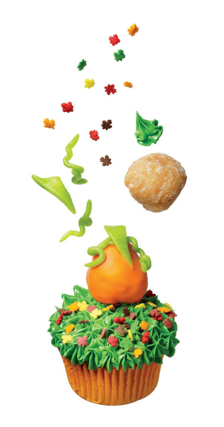 """<p>Here are a few tricks for this treat: Use green-tinted vanilla frosting for grass, a glazed doughnut hole dipped in orange frosting for the pumpkin, and strips of candy for the vines and leaves.</p><p><em><a href=""""https://www.womansday.com/food-recipes/food-drinks/recipes/a11409/great-pumpkin-cupcake-recipe-122726/"""" rel=""""nofollow noopener"""" target=""""_blank"""" data-ylk=""""slk:Get the recipe from Woman's Day »"""" class=""""link rapid-noclick-resp"""">Get the recipe from Woman's Day »</a></em></p>"""
