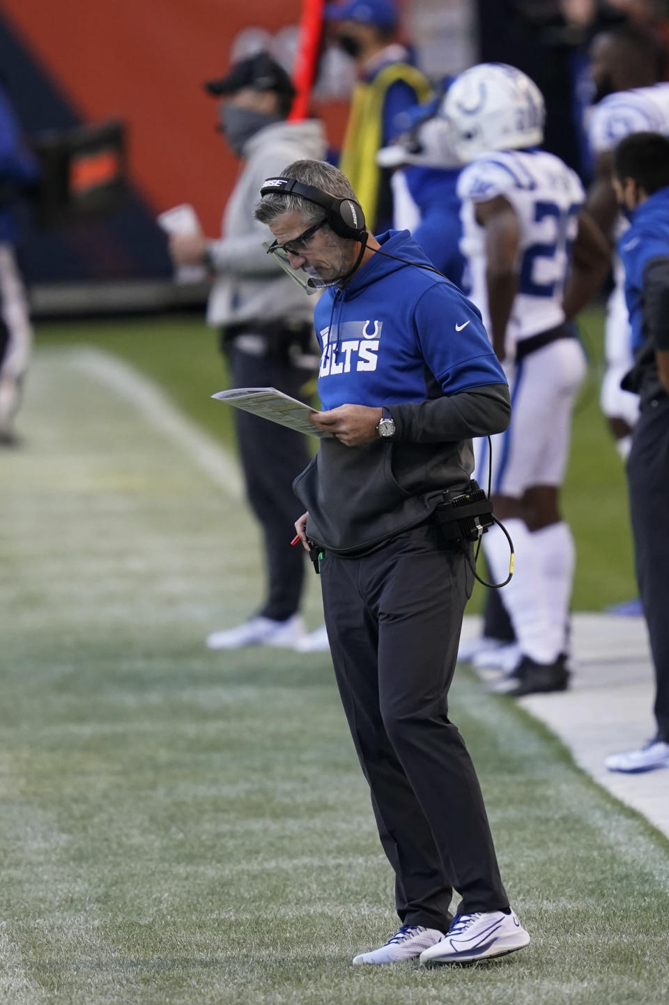 Indianapolis Colts coach Frank Reich looks at his play chart during the second half of the team's NFL football game against the Chicago Bears, Sunday, Oct. 4, 2020, in Chicago. (AP Photo/Charles Rex Arbogast)
