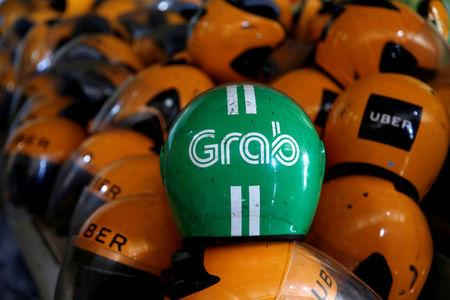 Anti-trust body sees 'virtual monopoly' in Grab-Uber merger
