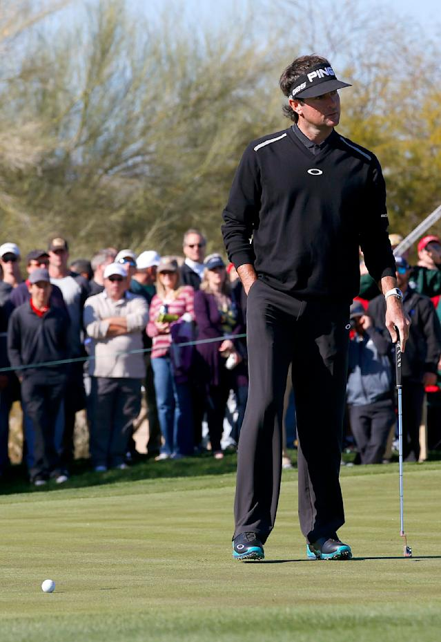 Bubba Watson looks over at his caddie after missing a birdie putt on the second hole during the final round of the Phoenix Open golf tournament on Sunday, Feb. 2, 2014, in Scottsdale, Ariz. (AP Photo/Ross D. Franklin)