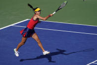 Emma Raducanu, of Great Britain, returns a shot to Sara Sorribes Tormo, of Spain, during the third round of the US Open tennis championships, Saturday, Sept. 4, 2021, in New York. (AP Photo/Seth Wenig)
