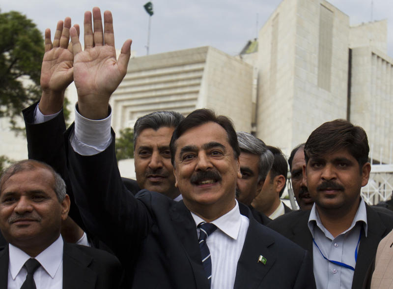 In this Wednesday, March 13, 2013, photo, Pakistan's ousted Prime Minister Yusuf Raza Gilani waves outside the Supreme Court in Islamabad, Pakistan after submitting an appeal to quash his five-year disqualification, for the upcoming elections. Pakistan's parliament is passing a remarkable milestone in a country that has faced three military coups -- it's the first democratically elected legislative body to finish its term. (AP Photo/B.K. Bangash)