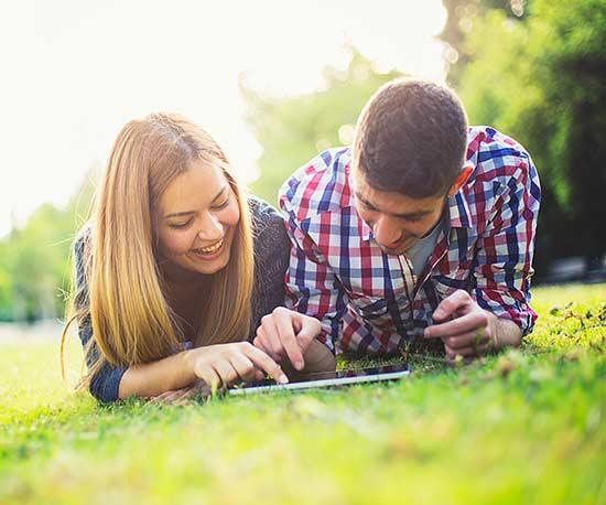 girl and guy laying in grass