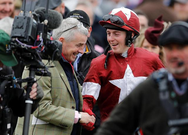 Horse Racing - Cheltenham Festival - Cheltenham Racecourse, Cheltenham, Britain - March 14, 2018 K M Donoghue celebrates with Ryanair Chief Executive Michael O'Leary after winning the 16:10 Glenfarclas Chase on Tiger Roll REUTERS/Darren Staples