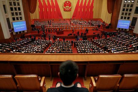 Delegates cast ballots during a vote on a constitutional amendment lifting presidential term limits, at the third plenary session of the National People's Congress (NPC) at the Great Hall of the People in Beijing, China March 11, 2018. REUTERS/Damir Sagolj