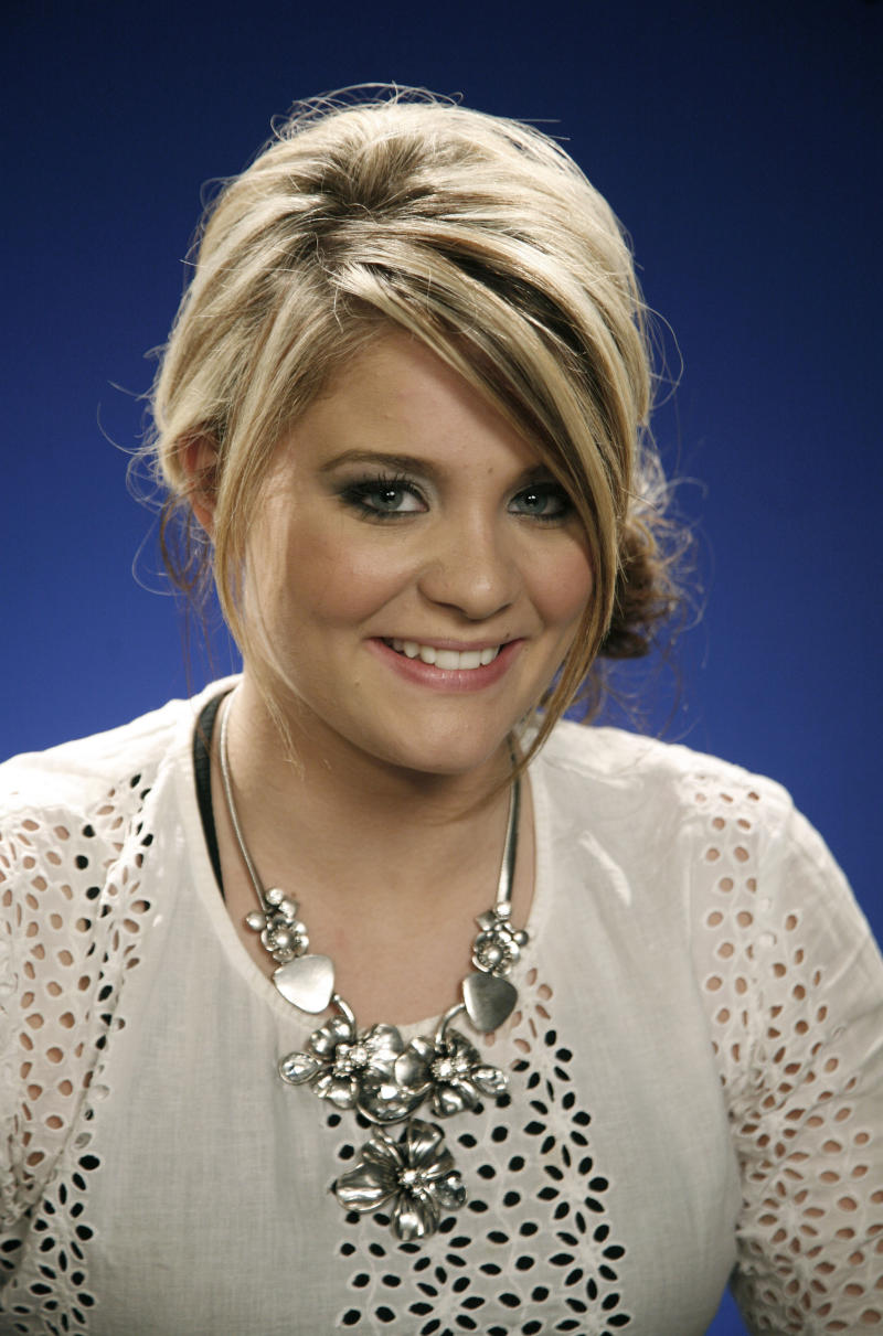 """FILE - In this May 31, 2011 file photo, singer Lauren Alaina, a runner up on the singing competition series """"American Idol,"""" poses for a portrait in New York.  Alaina's debut album, """"Wildflower,"""" was released on Tuesday. (AP Photo/Jeff Christensen, file)"""