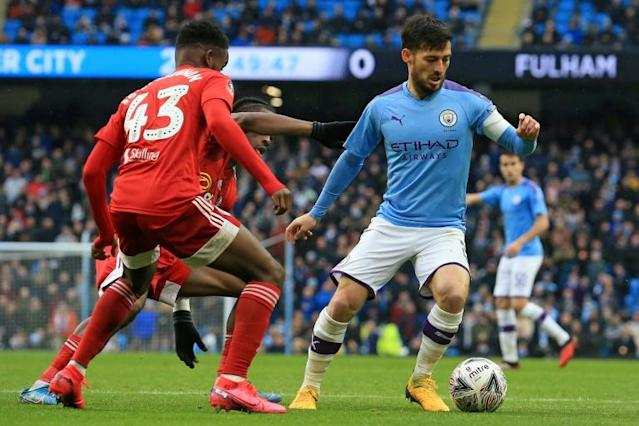 Manchester City's Spanish midfielder David Silva (R) is among the leading names whose contracts expire at the end of June (AFP Photo/Lindsey Parnaby)