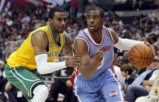 Los Angeles Clippers guard Chris Paul, right, drives around Memphis Grizzlies guard Mike Conley during the first half of an NBA basketball game in Los Angeles, Thursday, Jan. 26, 2012. (AP Photo/Chris Carlson)