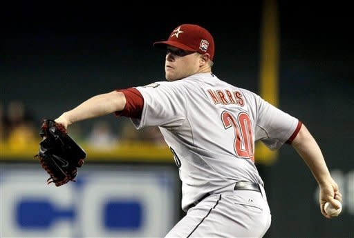 Houston Astros' Bud Norris (20) throws against the Arizona Diamondbacks during the first inning in a baseball game on Friday, July 20, 2012, in Phoenix. (AP Photo/Ross D. Franklin)