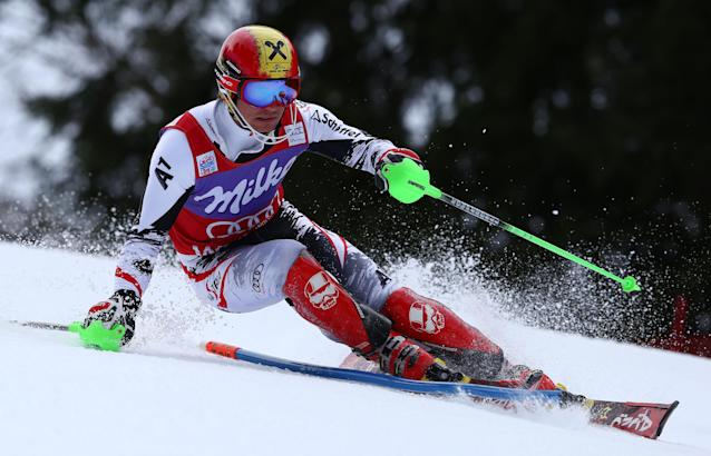 Austria's Marcel Hirscher clears a gate during the first run of an alpine ski, men's World Cup slalom, in Wengen, Switzerland, Sunday, Jan. 19, 2014. (AP Photo/Alessandro Trovati)