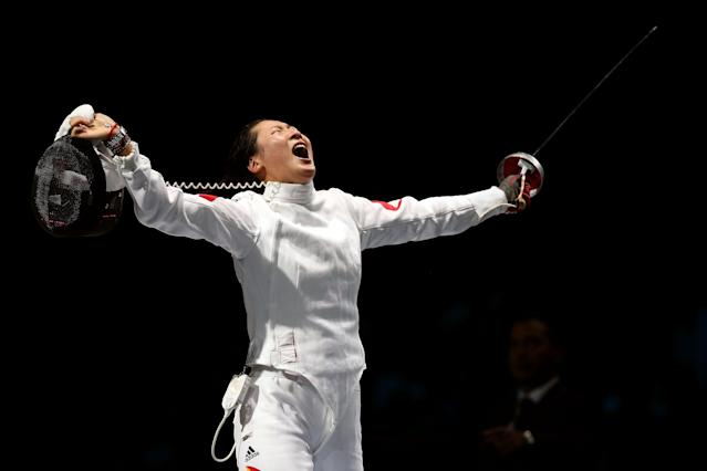LONDON, ENGLAND - JULY 30: Yujie Sun of China celebrates after defeating A Lam Shin of Korea to win the Bronze Medal Bout in the Women's Epee Individual Fencing on Day 3 of the London 2012 Olympic Games at ExCeL on July 30, 2012 in London, England. (Photo by Ezra Shaw/Getty Images)