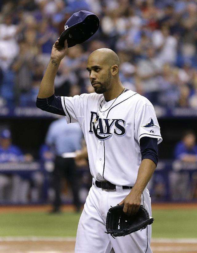 Tampa Bay Rays starting pitcher David Price tips his hat to the crowd after being taken out of the game against the Toronto Blue Jays during the eighth inning of a baseball game Monday, March 31, 2014, in St. Petersburg, Fla. (AP Photo/Chris O'Meara)
