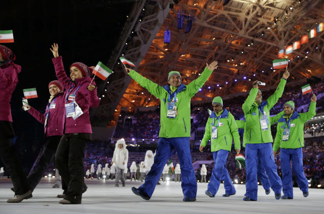 Members of the Iranian team enter the stadium during the opening ceremony of the 2014 Winter Olympics in Sochi, Russia, Friday, Feb. 7, 2014. (AP Photo/Patrick Semansky)